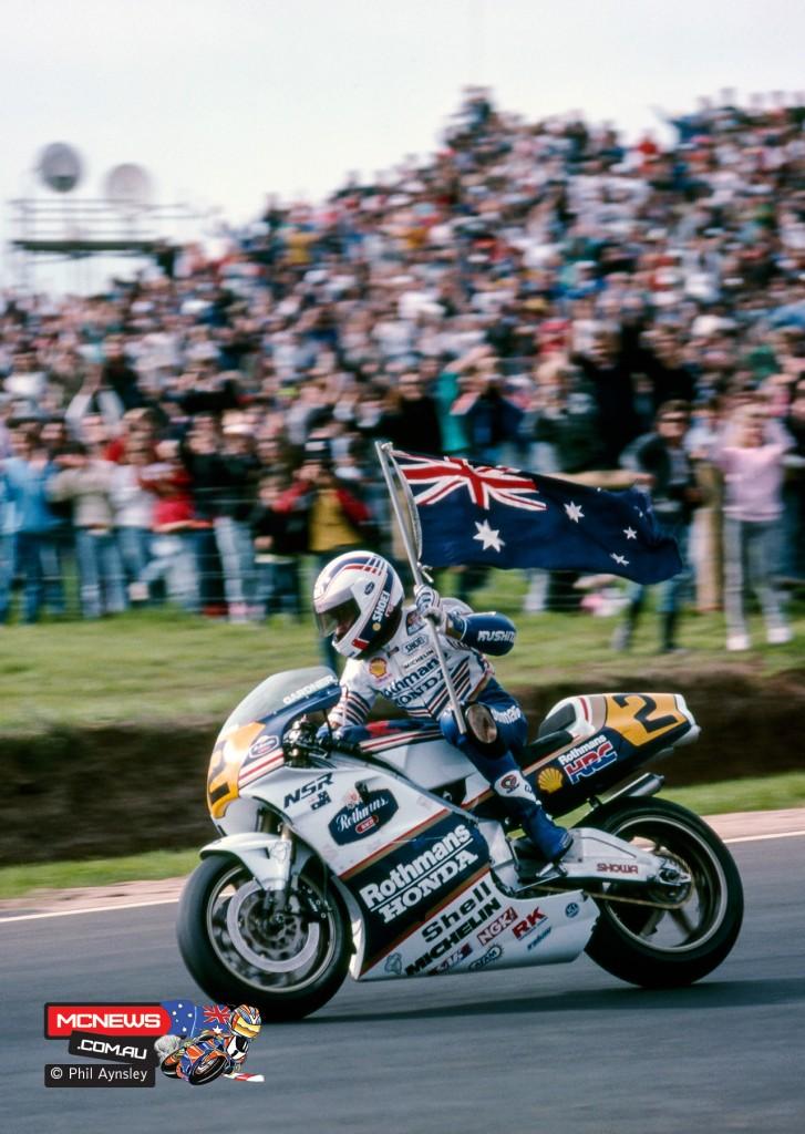 Wayne Gardner celebrates winning the inaugural Phillip Island 500 Grand Prix. 1989. By Phil Aynsley