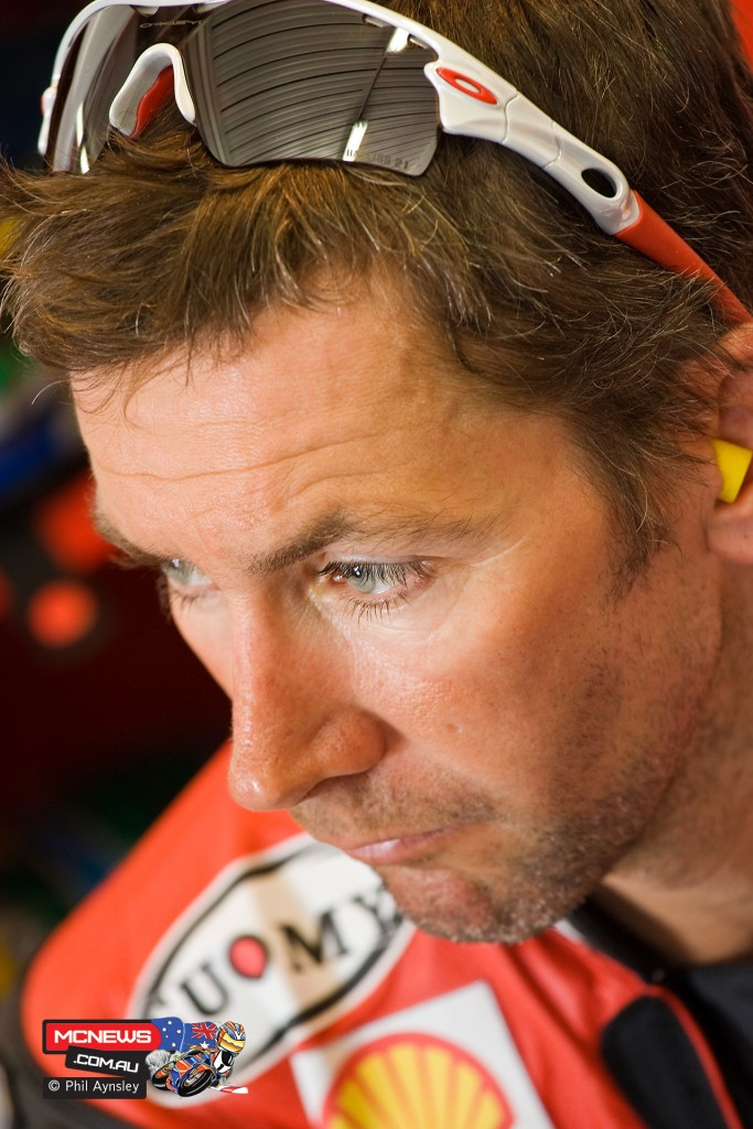Troy Bayliss in the pits during a quite moment at the 2008 WSBK round at Phillip Island. By Phil Aynsley