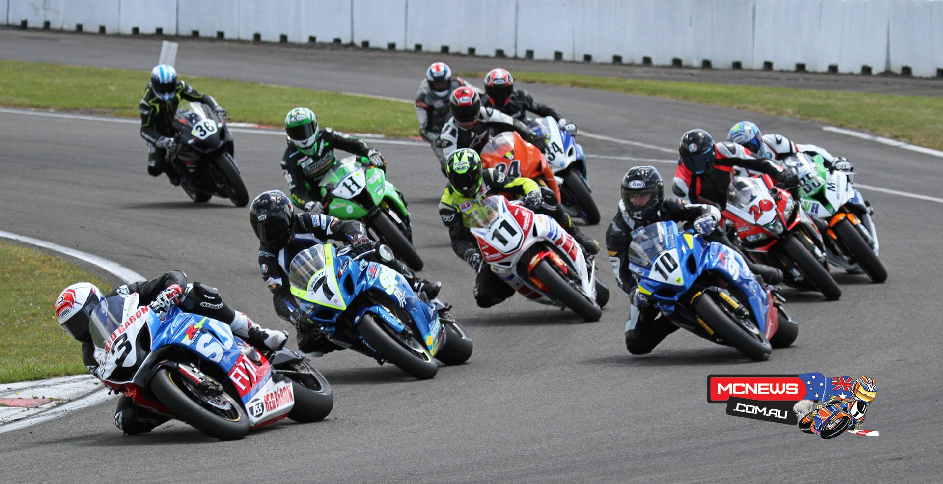 Sloan Frost leads the pack into the first corner in the opening F1 Superbike race