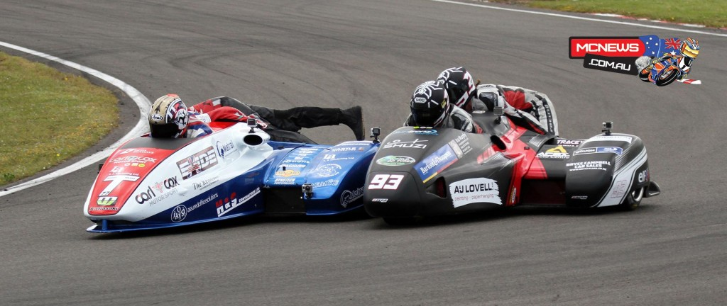 Tim Reeves passing Aaron Lovell at turn one during the opening sidecar race at Manfeild