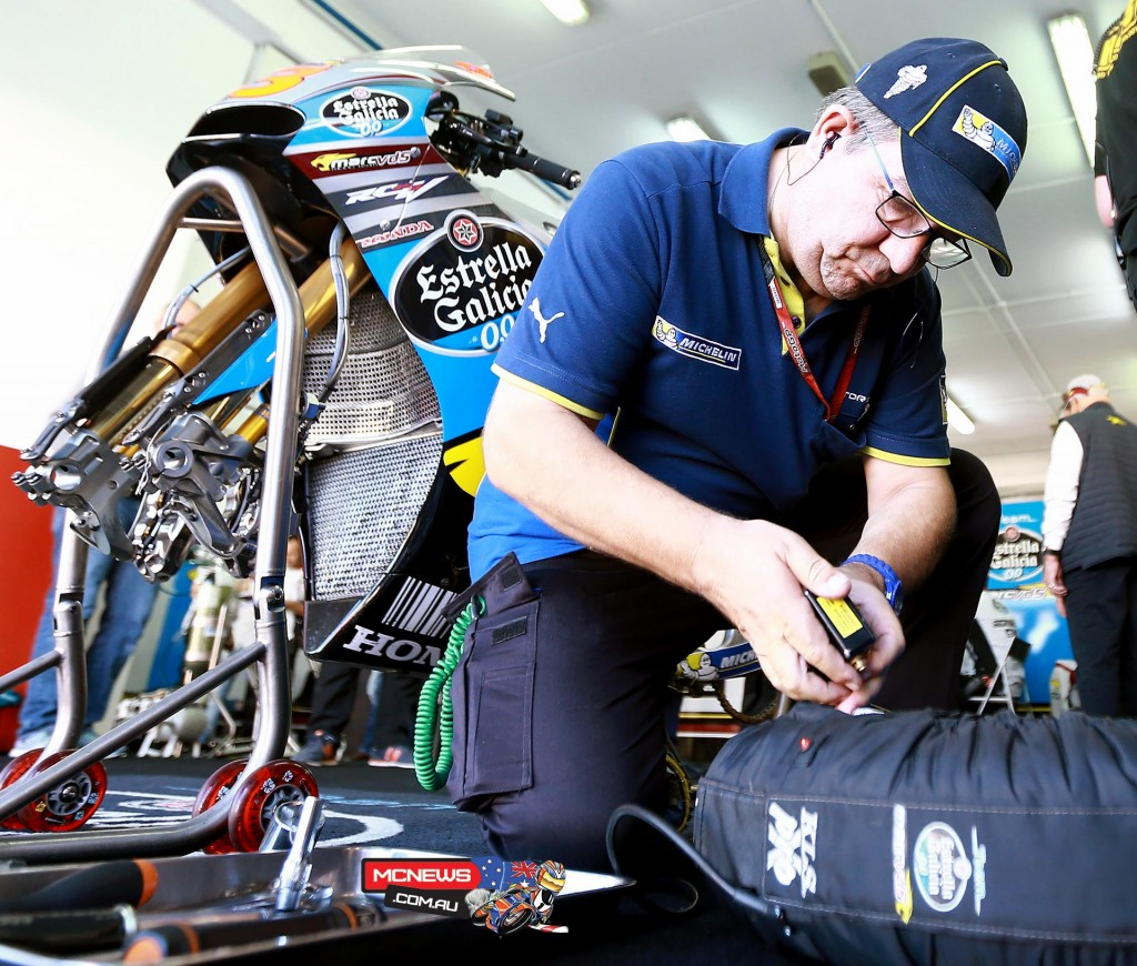 Michelin technician working with MarcVDS MotoGP
