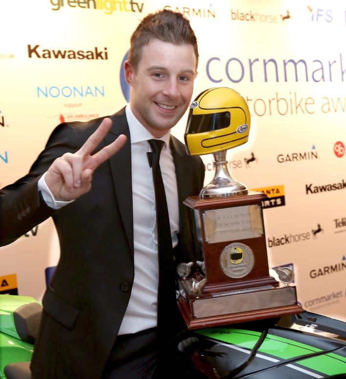 Jonathan Rea lifts Joey Dunlop Trophy aloft after being named Irish Motorcyclist of the Year