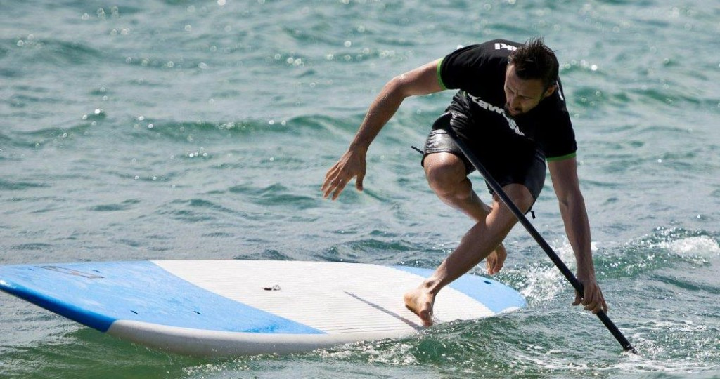Randy Krummenacher tries his hand at stand up paddle boarding off Cowes Beach
