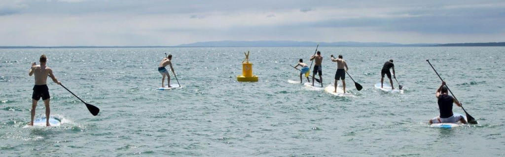 WorldSBK Riders stand up paddle boarding off Cowes Beach