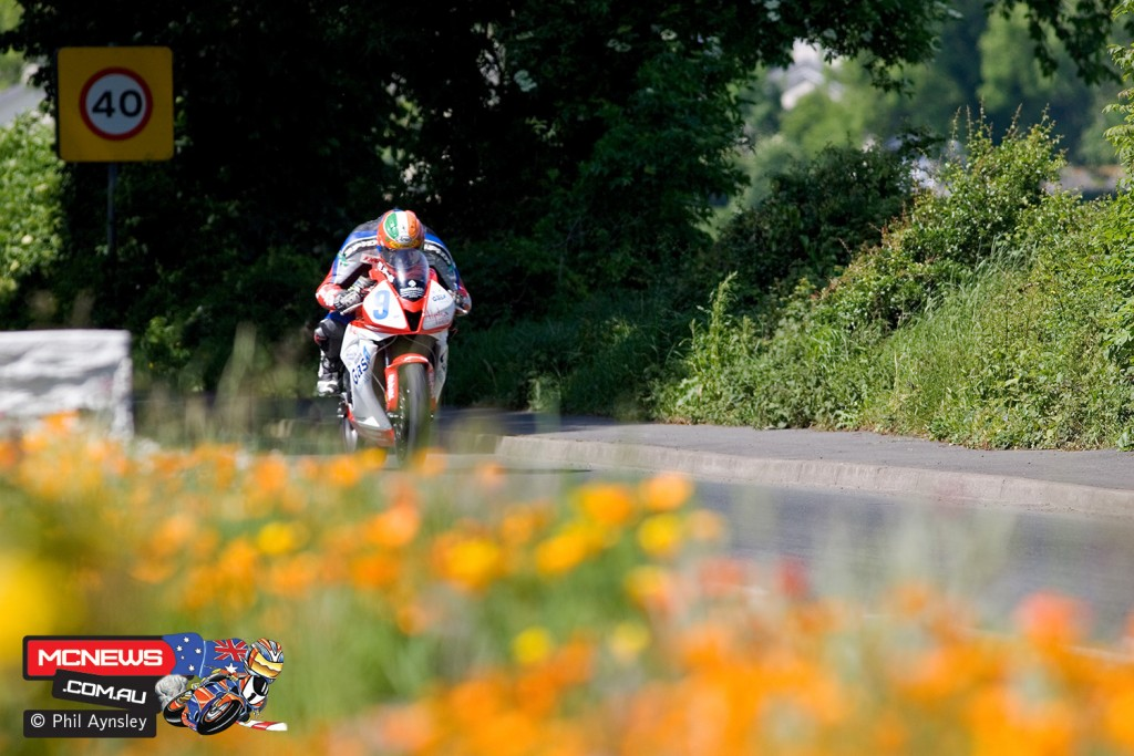 I'd spotted the flowerbed while driving around the course the day before. The speed limit sign was an added bonus! Martin Finnegan - Honda CBR RR during the Supersport TT on the fastest part of the course, Sulby Straight.