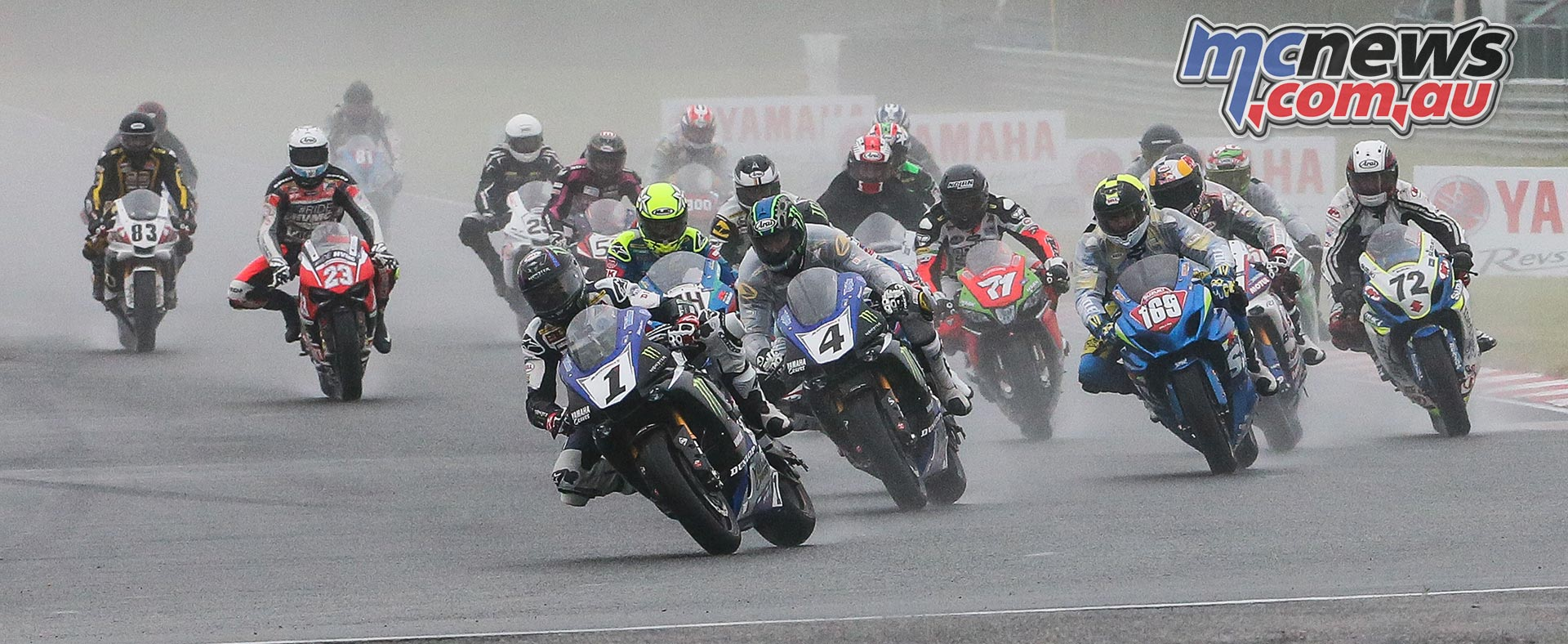 Cameron Beaubier (1) leads Josh Hayes (4), Hayden Gillim (169) and the rest of the Superbike pack in race two at NJMP. Photo by Brian J. Nelson.