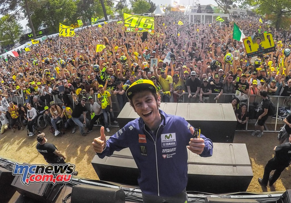 Valentino Rossi excited in front of his crowd of fans.