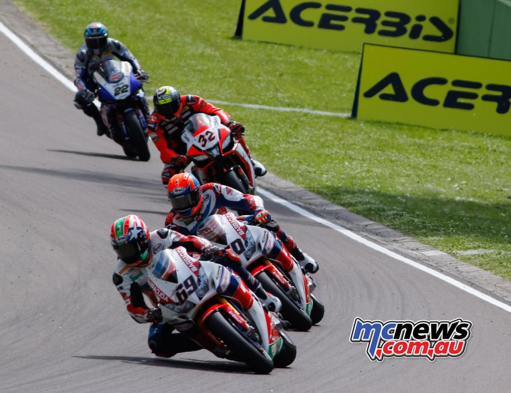 Nicky Hayden leads Michael Van Der Mark and Lorenzo Savadori