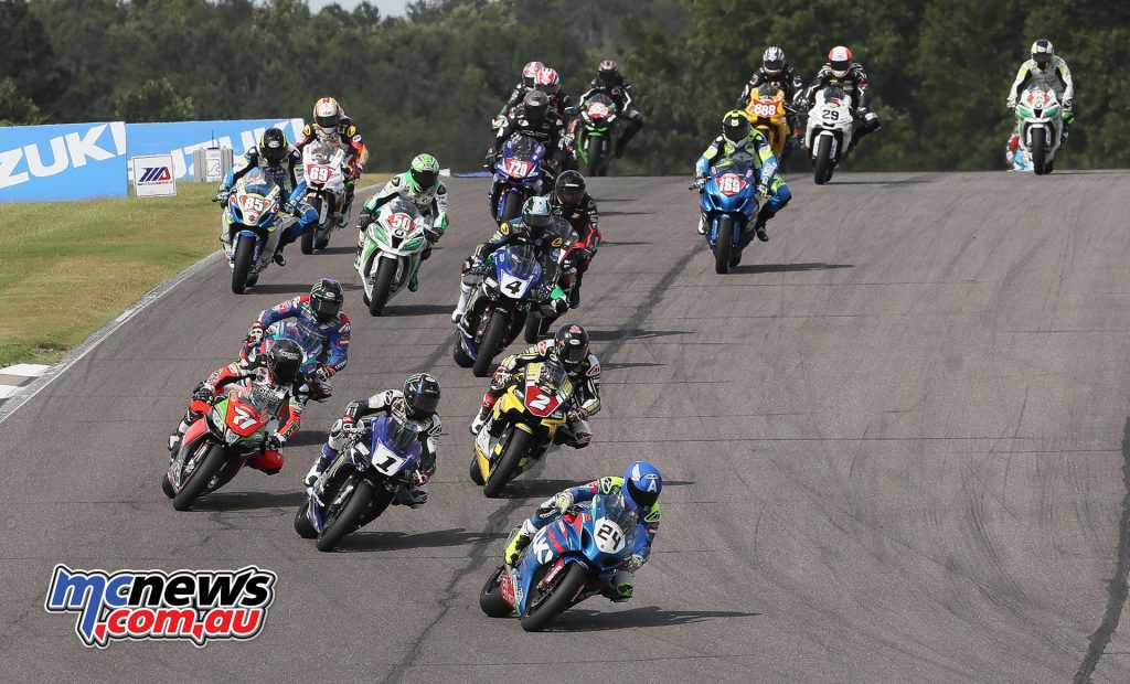 Toni Elias (24) leads Cameron Beaubier (1), Superstock 1000 winner Josh Herrin (2), Claudio Corti (71) and the rest of the Superbike field. Photo by Brian J. Nelson.