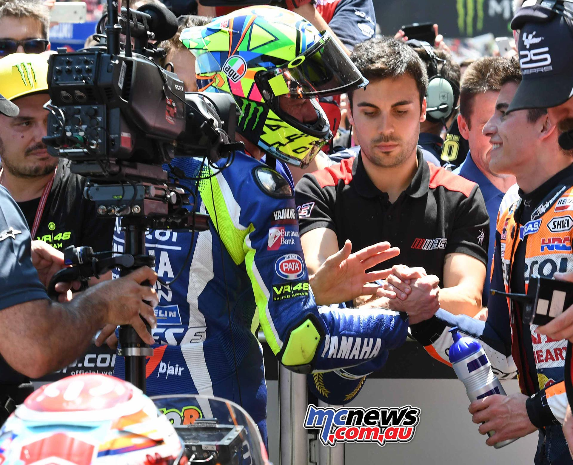 Valentino Rossi and Marc Marquez shake hands in Parc Ferme after a hectic battle at Catalunya MotoGP 2016