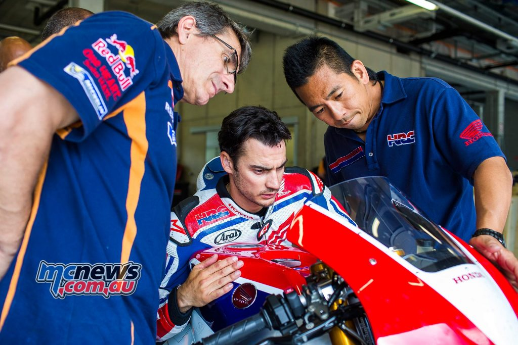 Dani Pedrosa with HRC technicians at Red Bull Ring, Austria