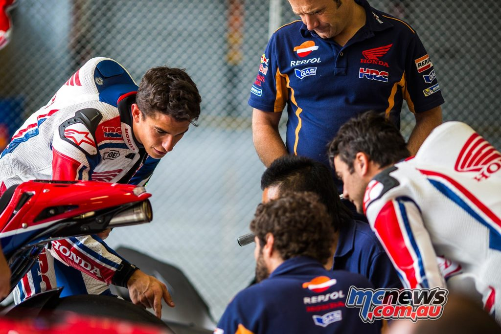 Marc Marquez with HRC technicians at Red Bull Ring, Austria