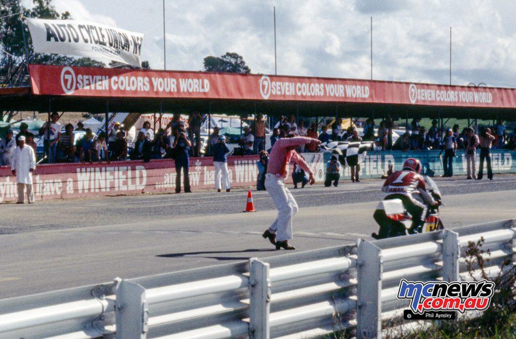Hidio Kanaya/Yamaha TZ750 taking the winner's flag.