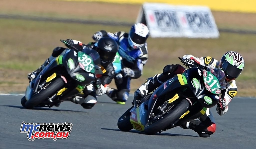 Ninja 300 Cup - Broc Pearson leads Tom Toparis at Queensland Raceway - Image by Keith Muir