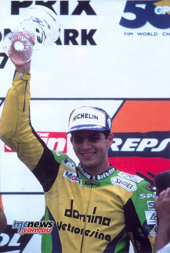 1997 - THE JOY OF THE FIRST PODIUM Donington, British Grand Prix: in his eleventh Grand Prix start, Gresini Racing enters already in the Olympus of motorcycling. Alex Barros is third behind the factory Hondas of Doohan and Okada, collecting thus the first in a long series of podium finishes.