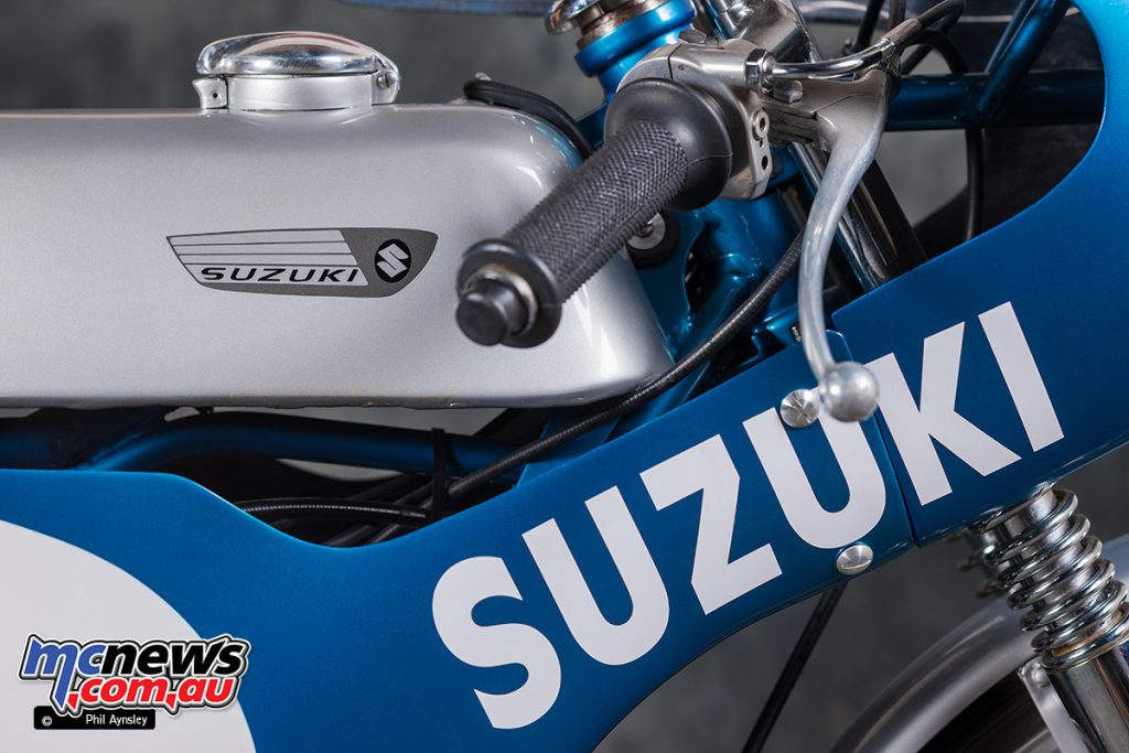 This 1967 Suzuki TR50 has been fitted with a works RK50 tank.