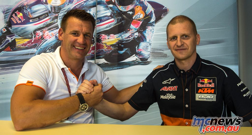 Pit Beirer and Aki Ajo sign the agreement at Misano