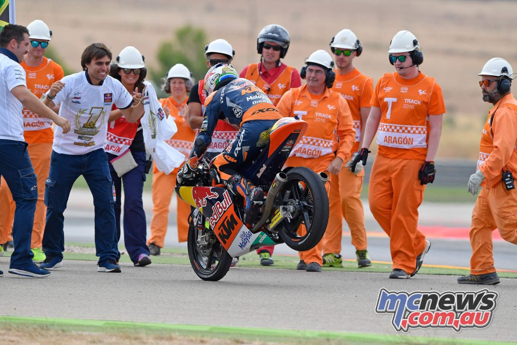 Moto3 Champion Brad Binder greeted by excited Red Bull KTM Ajo team members and course staff at Aragon.