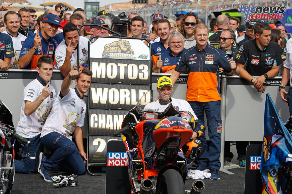 The Red Bull KTM Ajo team with Brad Binder celebrate in the pits.