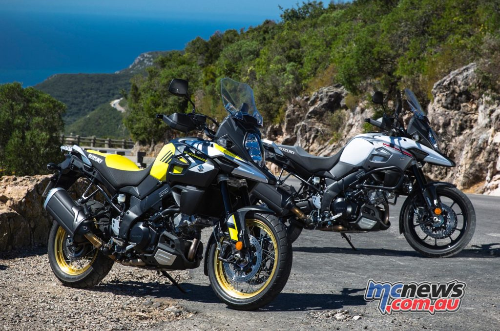 The 2017 Suzuki V-Strom 1000XT (front - yellow, spoked wheels) and V-Strom 1000 (back- white cast wheels).