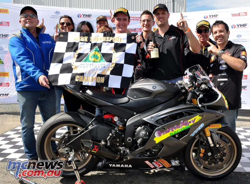 Troy Guenther and the Graffiti Alley Team celebrate victory in the 2016 Australian Supersport Championship