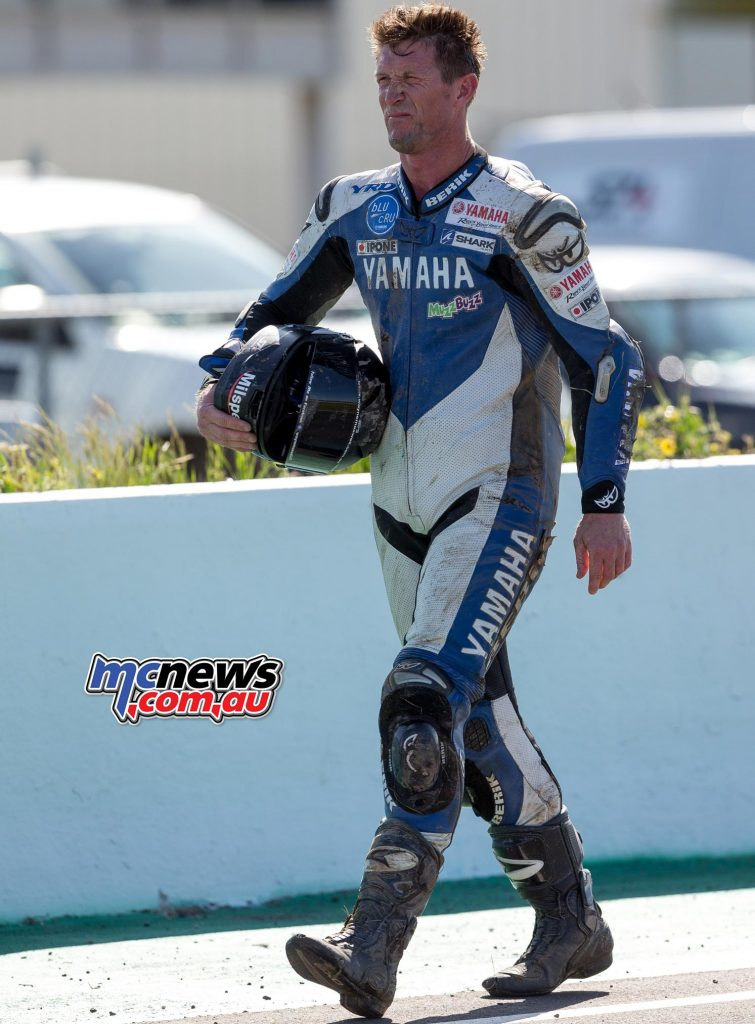 Wayne Maxwell walks back to the pits, his championship hopes gone - Image by Andrew Gosling