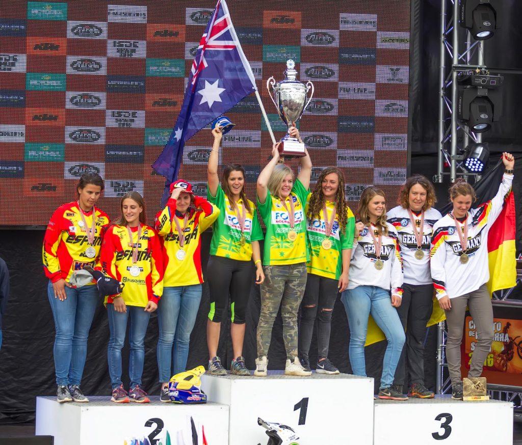 Yamaha Blu Cru Women's team celebrating on the ISDE podium - Mad Dog Images