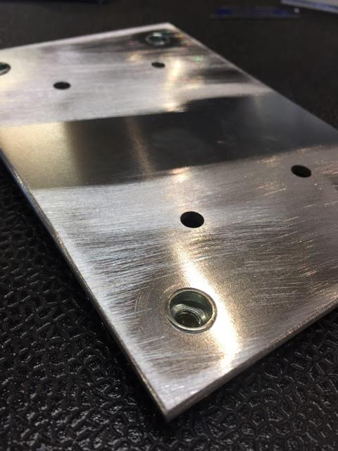 The base plate from underneath with the rivet nuts installed.