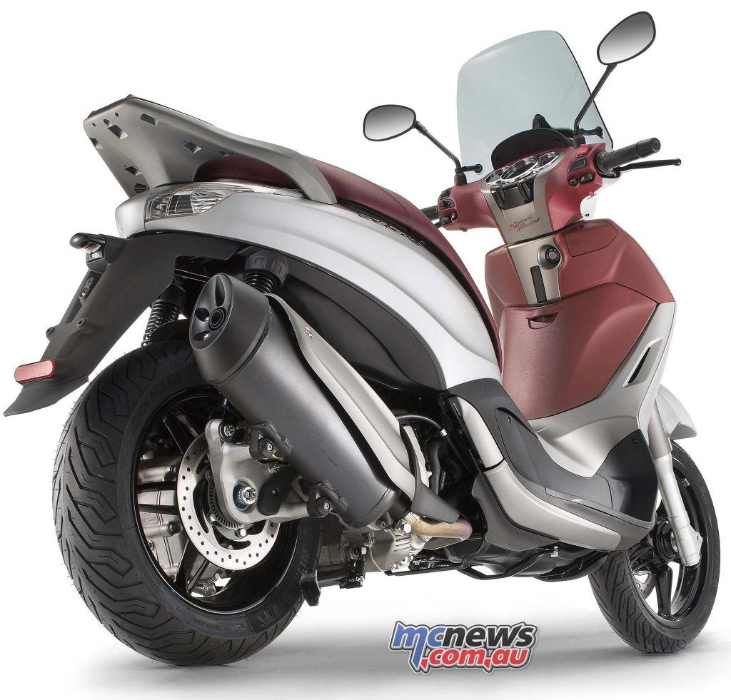 The Piaggio Beverly Sport Touring offers 400cc performance with 300cc weight and handling.