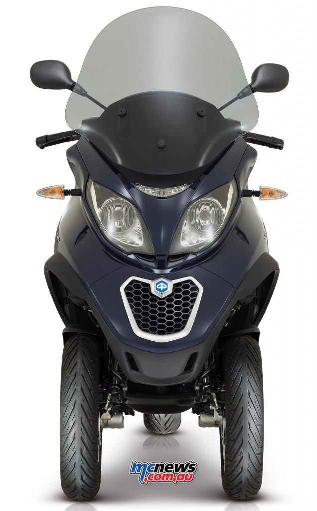 Piaggio MP3 300 Business. The headlight now includes LED daytime running lights and indicators are LED items.
