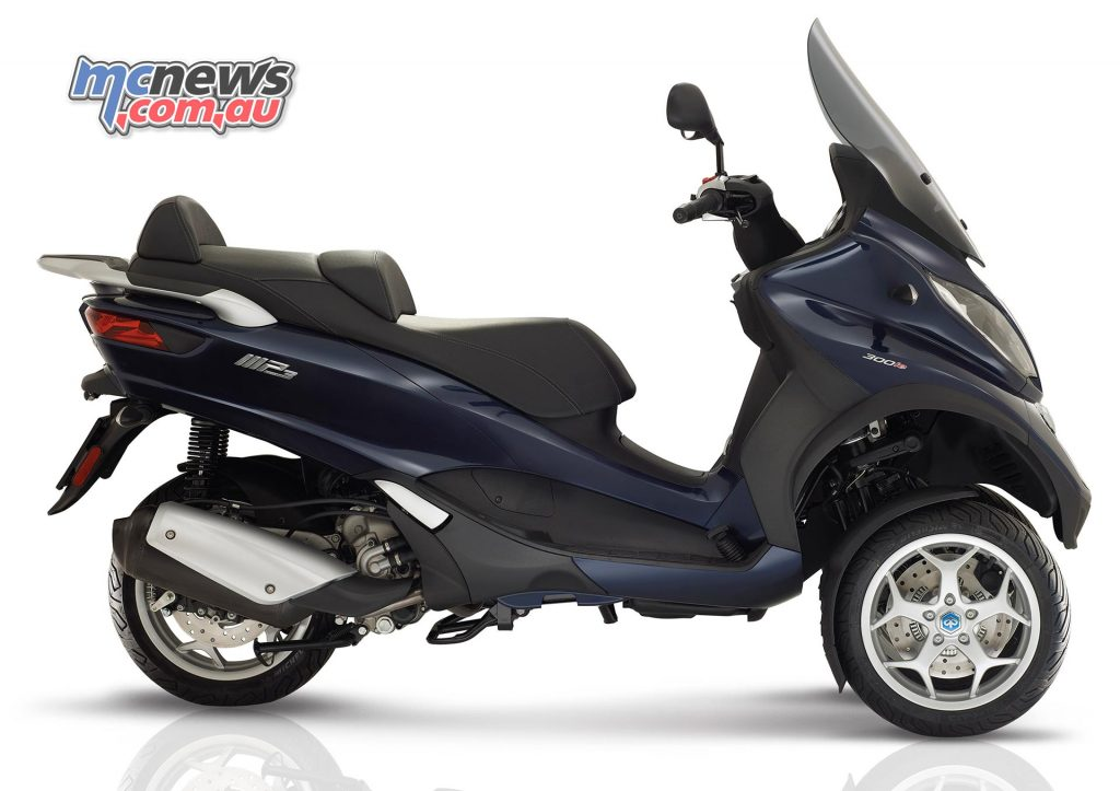Piaggio MP3 300 Business. Underseat storage has been optimised to fit two full face helmets.