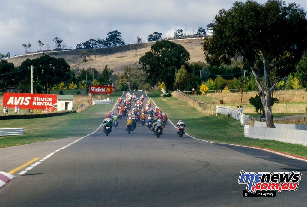Bathurst 1984 - The field heads up Mountain Straight on the first lap of the Arai 500.