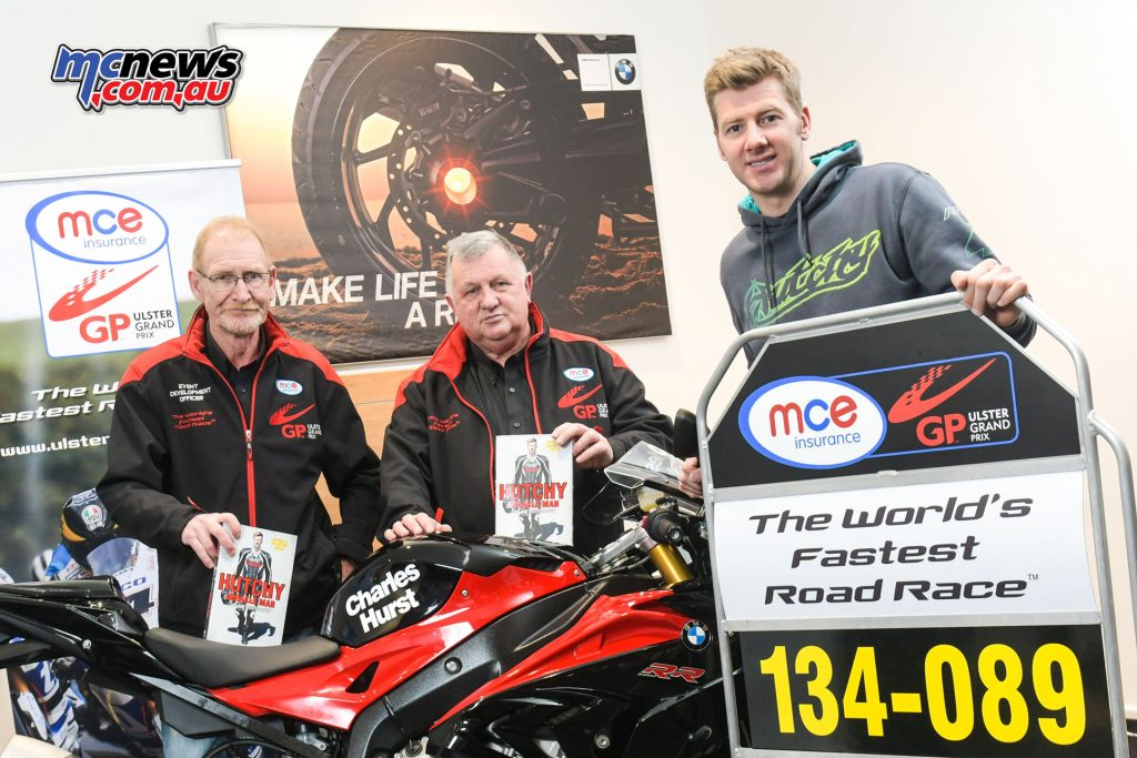 L-R: Ken Stewart and Eddie Johnston, Dundrod & District Motorcycle Club with the 2016 MCE UGP Man of the Meeting, Ian Hutchinson at his book signing at Charles Hurst BMW Motorrad on 3rd December.