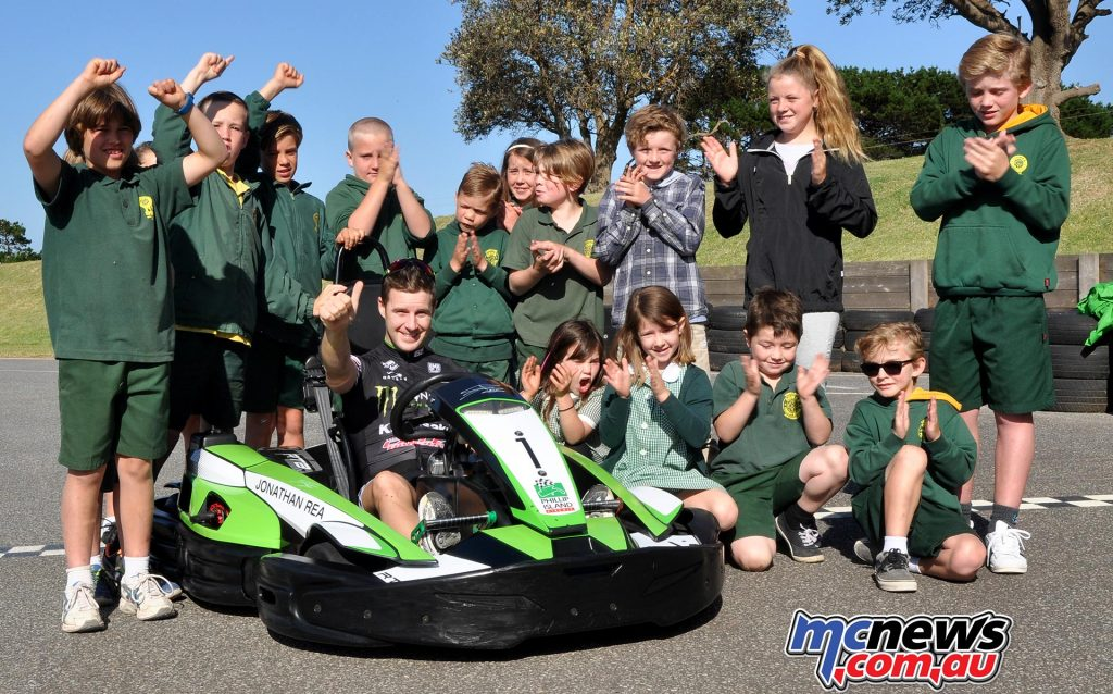 Cowes Primary School kids hauled Jonathan Rea onto their school bus and took him to the Phillip Island karting track where they had a gift to unveil, his own Jonathan Rea Go Kart liveried in Kawasaki green, complete with race number 1 and his name proudly emblazoned across the front.