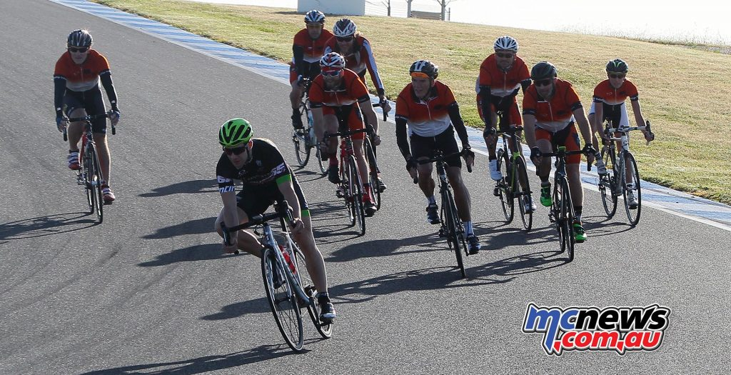 Jonathan Rea shows his cycling mate the fast line around Phillip Island - SD Pics