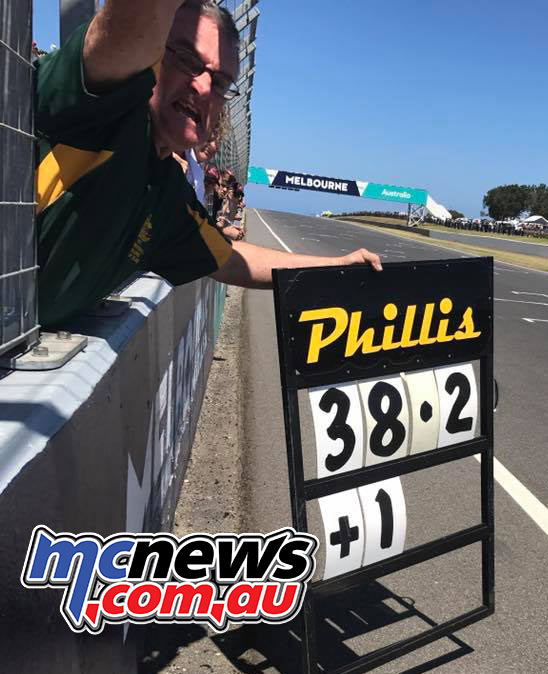 Robbie Phillis encourages son Alex from the pit wall at Phillip Island