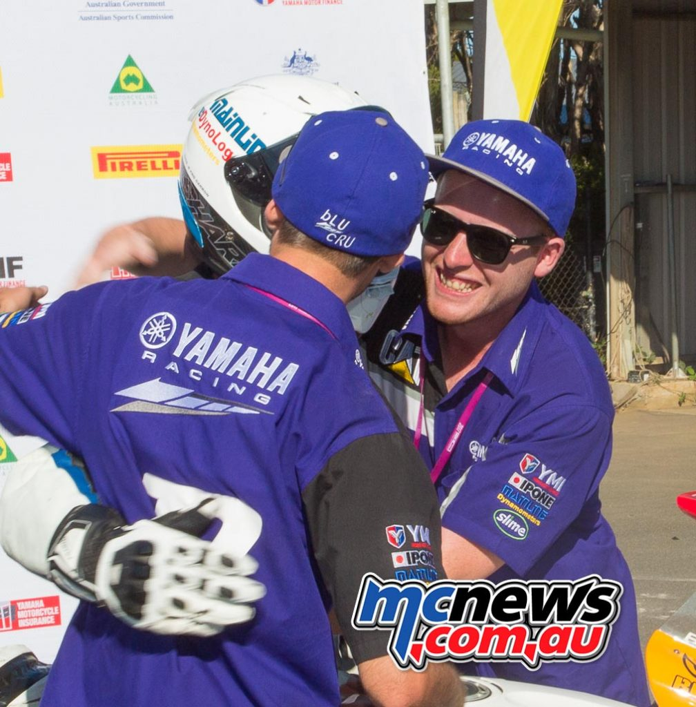 Daniel Falzon congratuled by brother Jon, his electronics guru, and good friend Liam Wilkinson in Parc Ferme after wrapping up a perfect result at the Phillip Island ASBK season opener - Image by Cameron White