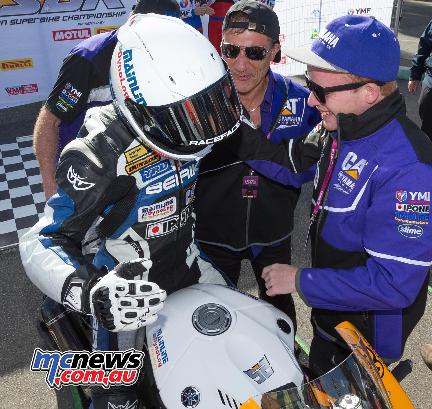 Daniel Falzon and team celebrate race one victory