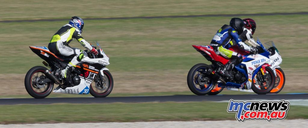 Zac Levy alongside Tom Edwards - Supersport 300 Race Three at Phillip Island - ASBK 2017 - Round One - Image by TBG