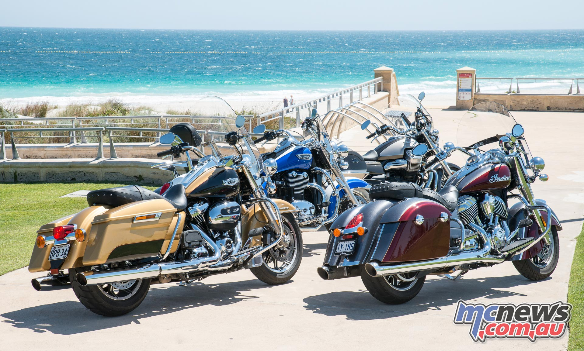 Harley Road King, Indian Springfield, Triumph Thunderbird LT and Moto Guzzi California Touring overlooking Sorrento Beach across to the Indian Ocean.