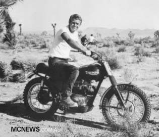 Steve McQueen on one of his many Triumph motorcycles