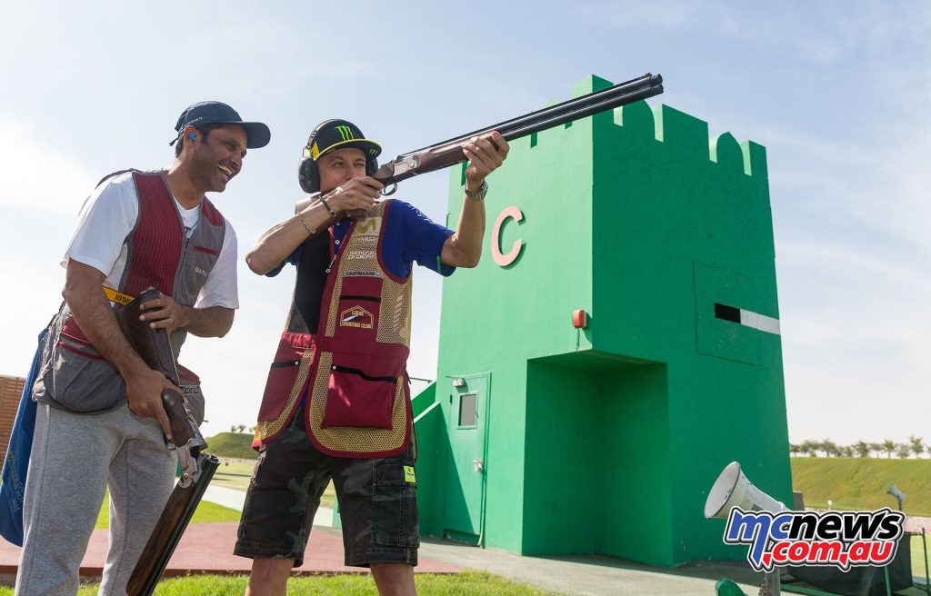 Nasser Al-Attiyah shares some shooting tips with Valentino Rossi