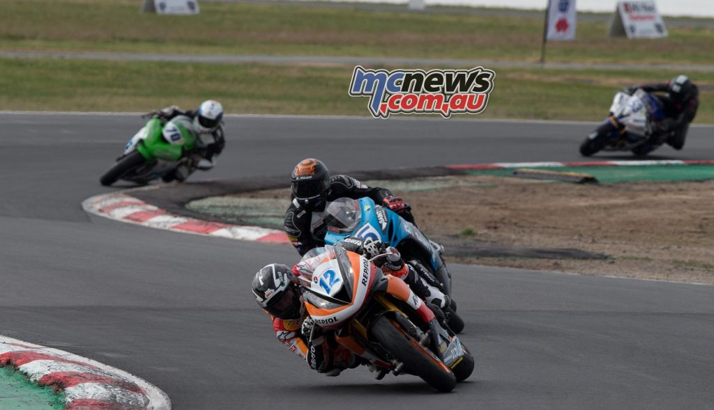 Mark Chiodo leads Ted Collins on lap two at Winton