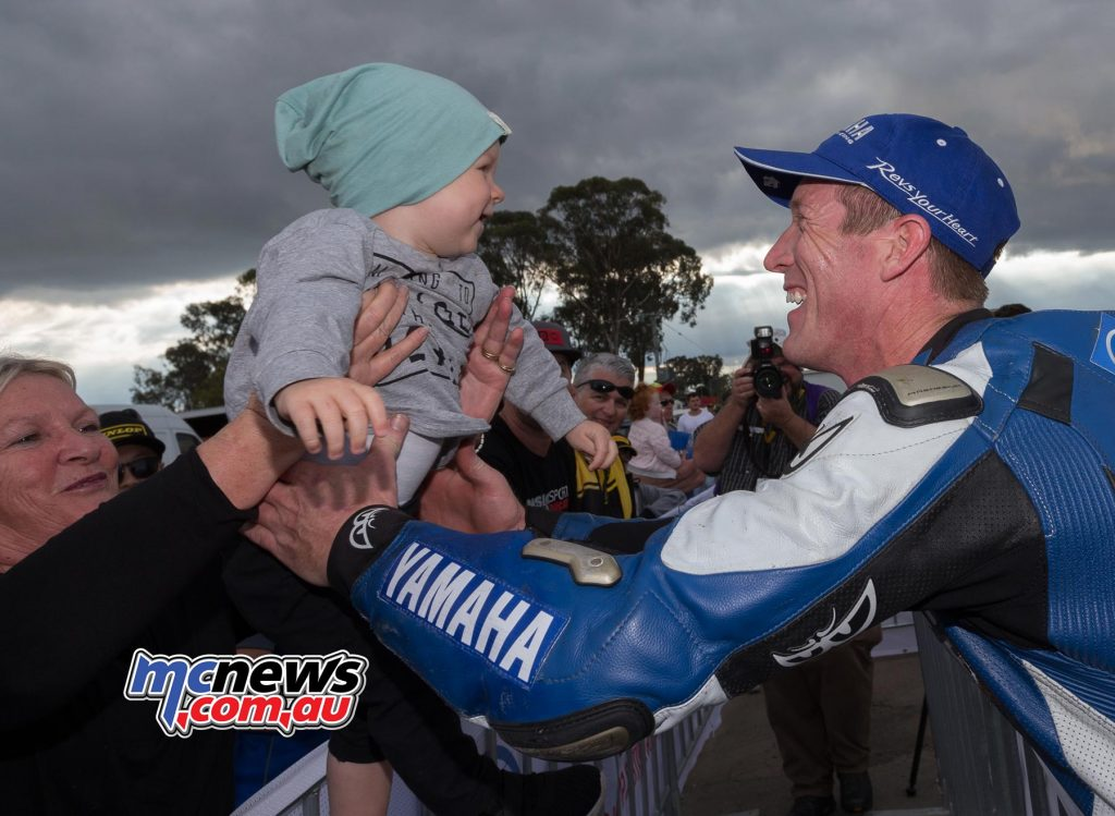 Wayne Maxwell celebrates victory with son Archie