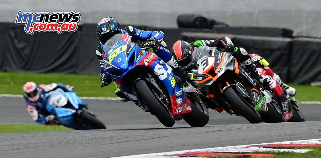 Sylvain Guintoli being chased by Billy McConnell