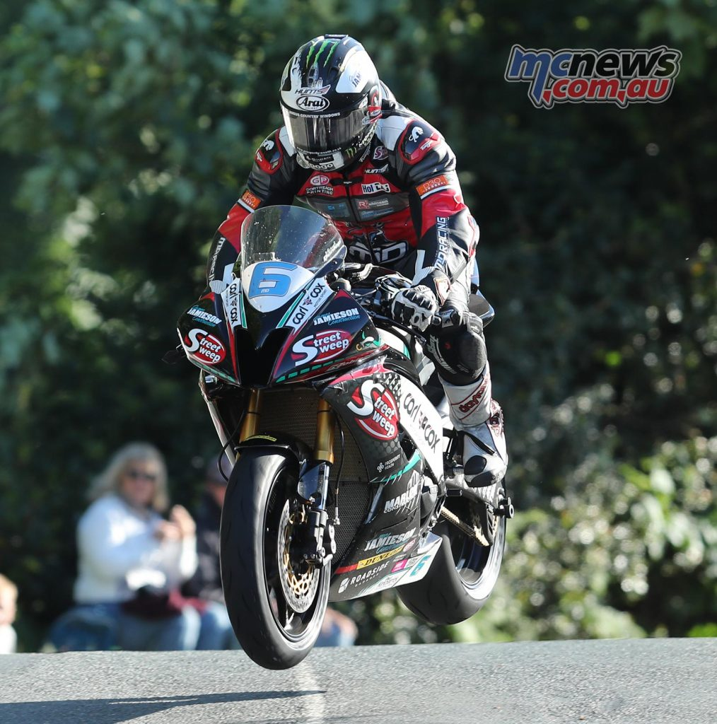 Absolute lap record holder Michael Dunlop flies over Ballaugh Bridge on his Supersport machine