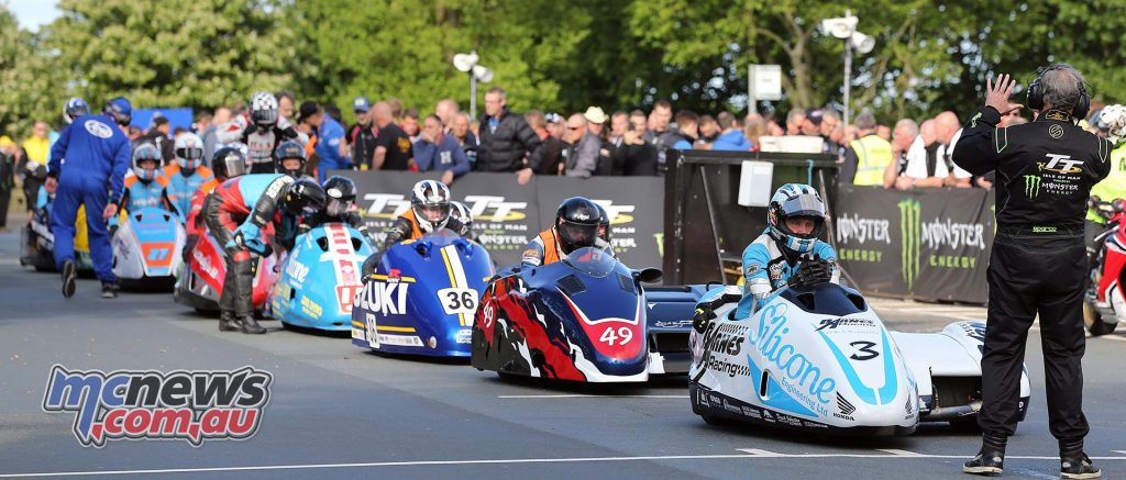 Sidecar newcomers set off for their compulsory speed controlled lap of the Course