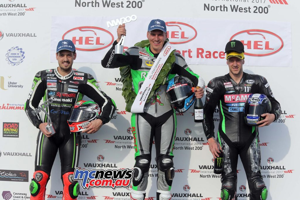 Alastair Seeley atop the podium after taking Supersport victory at the 2017 NW200 ahead of Ian Hutchinson and James Hillier