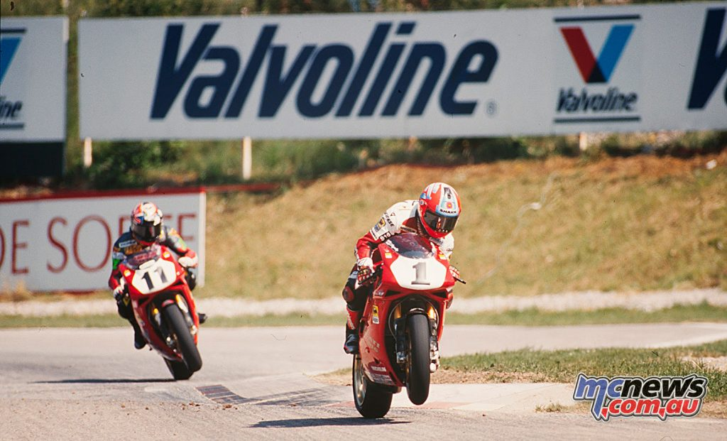 Troy Corser chasing Carl Fogarty