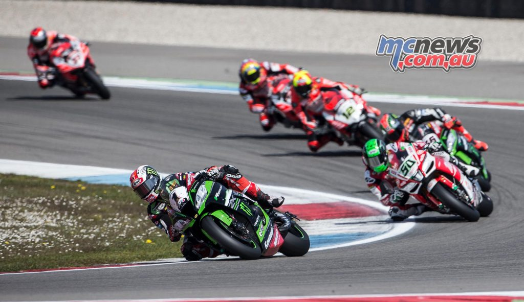 Jonathan Rea took victory from Sykes by a tiny margin, making it seven wins from eight races.